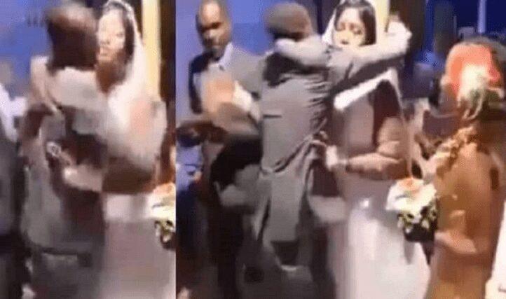 Jealous Bridegroom beats best man for hugging bride [Video]
