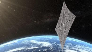 Lightsail 2 in space: spacecraft orbiting the Earth in sunlight