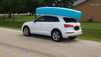 Mother drives around with an inflatable swimming pool on the roof, with daughters in it