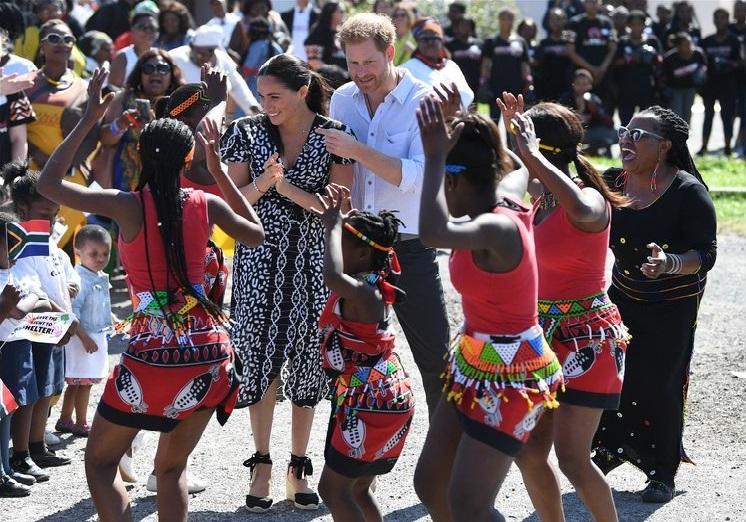 Harry and Meghan tease a dance in Cape Town