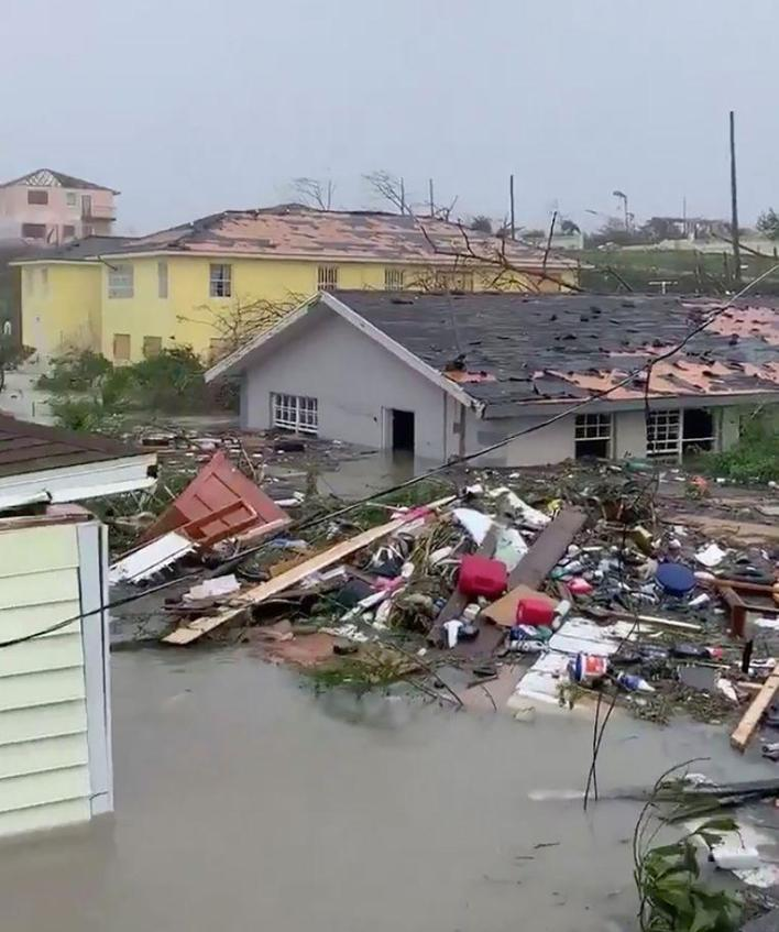 """""""Catastrophic damage"""" and killing in Bahamas after hurricane crossing, Florida braces itself"""