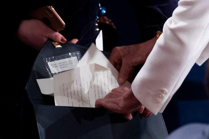 Pelosi puts the torn copy in an envelope that will be sent back to the White House