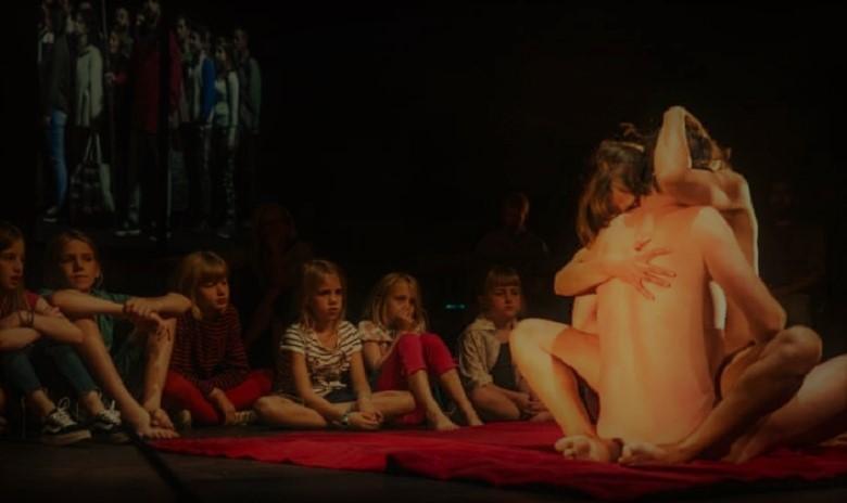Saluting: actors make love for children in 'Lam Gods' play