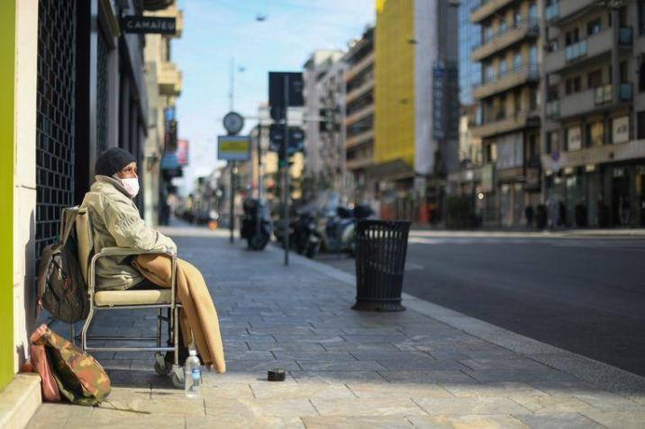 A homeless person also wears a mask on a deserted street in Buenos Aires, the capital of Argentina.
