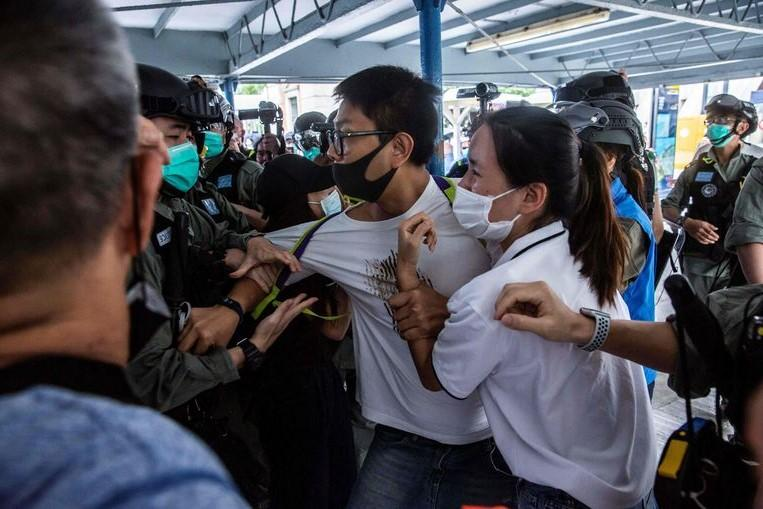 Hundreds of protesters take to the streets in Hong Kong again