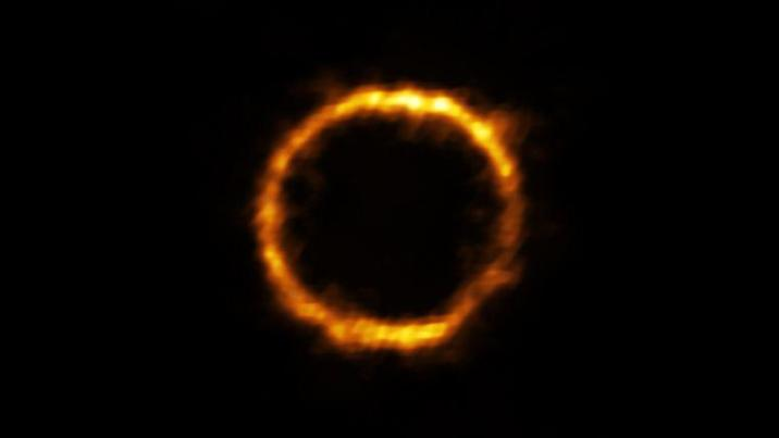 ESO took advantage of a nearby galaxy that acts as a powerful magnifying glass to observe SPT0418-47, also known as the Gravity Lens Effect. SPT0418-47 appears as a nearly perfect ring of light around the lens galaxy, because the two galaxies are almost exactly aligned.