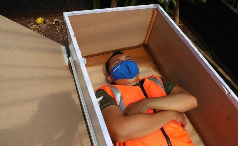 Man avoids Covid-19 fine by sleeping in a coffin for a minute