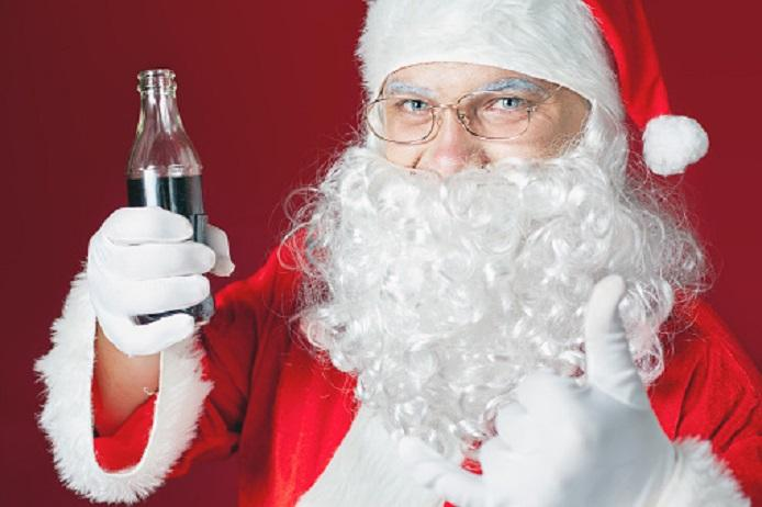 Funny Santa Claus holding Coca Cola fresh beverage at glass bottle