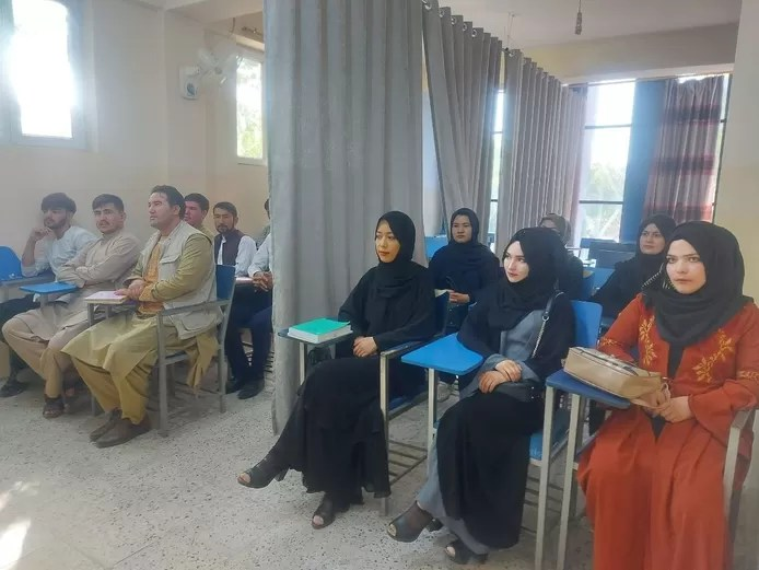 Afghan universities reopen: Photos show curtain separating male and female students
