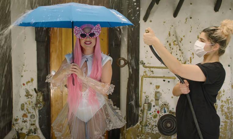 """Lady Gaga and Ariana Grande present weather forecast: """"We are soaked"""""""
