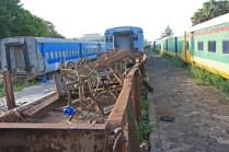 """La gare sert désormais de dépôt. On aperçoit ici des rames du Petit train de banlieue (en bleu) / The train station is now used as a depot. The blue trains are commuter trains called """"Petit train de banlieue"""""""