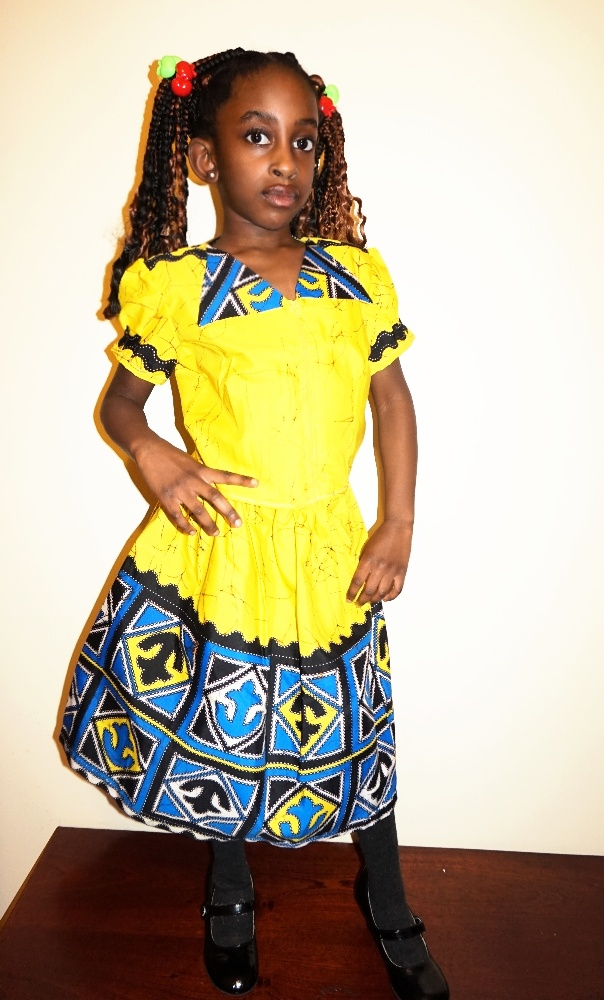 Girls yellow and blue symbols print skirt and top set