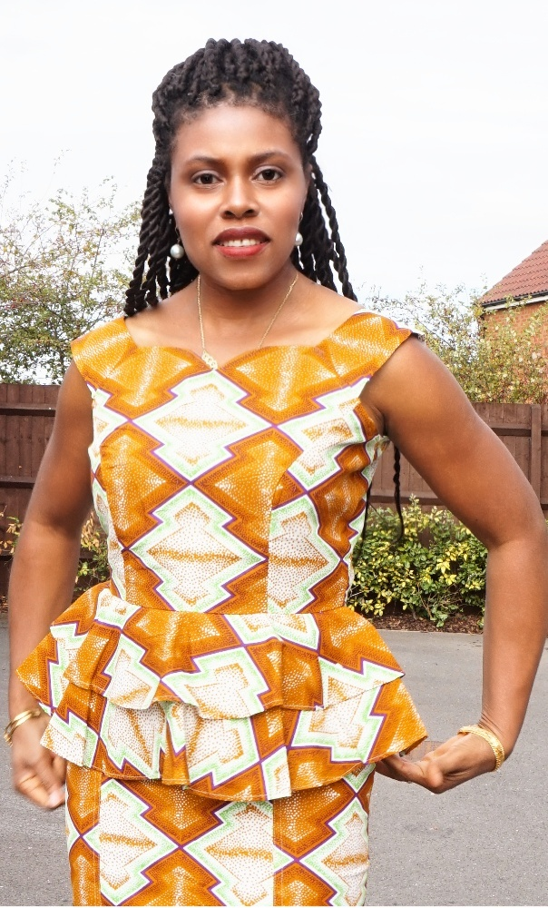 African print sleeveless peplum top and pencil skirt