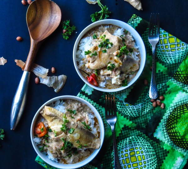 Warm West African Peanut Soup with Tilapia served over a bed of fragrant Jasmine rice