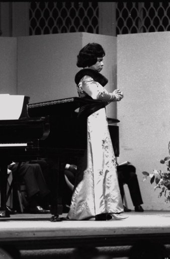 "Marian Anderson, the first African American soloist ever to perform at the Metropolitan Opera House, sings ""Ave Maria"" on the stage of Carnegie Hall, in what was billed as her farewell performance, April 18, 1965. (AP photo/Dave Pickoff)"