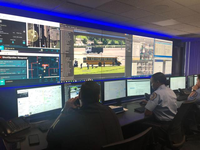 A Freight Dispatcher Sitting in Front of Multiple Large Screens