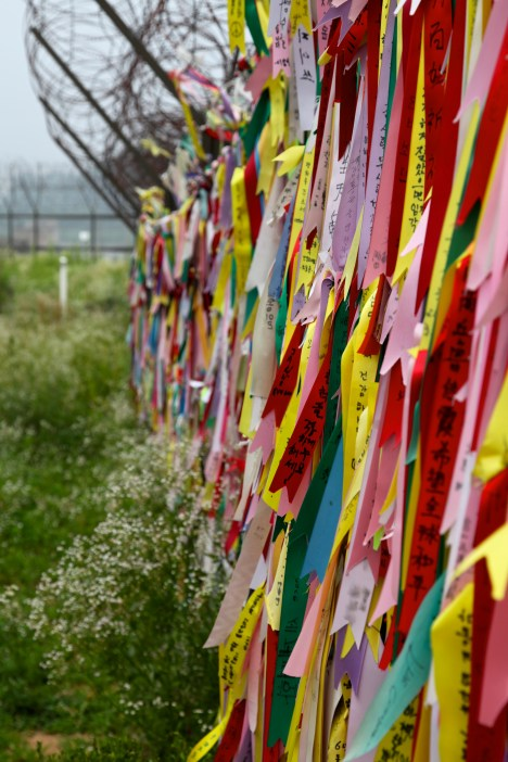 people write notes about peace/to their relatives across the boarder and leave them on the fence.
