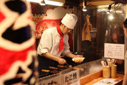 cooking takoyaki.