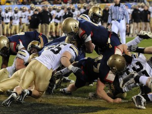 Navy quarterback Ricky Dobbs keeps the ball and punches into the endzone from the one-yard line for a touchdown, putting Navy up 16-3 in the fourth quarter. Navy kicker Joe Buckley scored the PAT and put the game away 17-3. That touchdown gave him an NCAA single-season record of 24 rushing touchdowns, breaking the record held by Florida's Tim Tebow.