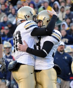 Army kicker Alex Carlton, rihgt, celebrates with holder Kolin Walk, left, after kicking a fieldgoal in the first quarter to put Army ahead 3-0. (Alan Lessig/Staff)