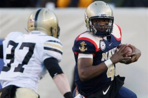 Navy's Ricky Dobbs carries the ball during the Midshipmen's 17-3 win over Army.  (AP Photo/Matt Rourke)