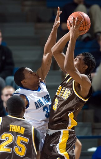 Evan Washington defends Wyoming guard Desmar Jackson in the second half Saturday.   (AP Photo/The Gazette, Kevin Kreck)