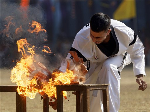 An Indian army soldier displays martial art skills at the celebration of Corps of Signals' 99th Corps Day, in New Delhi on Feb. 6. (AP Photo/Gurinder Osan)