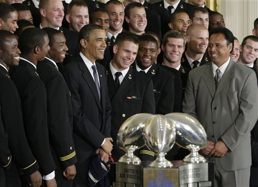 President Obama poses for a photo with the Naval Academy's 2009 football team in the East Room of the White House on Monday. (AP Photo/J. Scott Applewhite