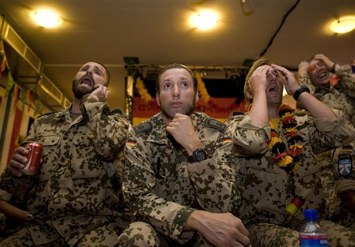 German soldiers react as they watch their team play against Serbia at World Cup soccer, Friday, June 18, 2010 at their base in Kunduz, Afghanistan. (AP Photo/Dusan Vranic)