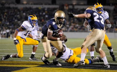 Ricky Dobbs scores a touchdown against Delaware in the second half of Navy's 35-18 win over the Blue Hens. (AP Photo/Gail Burton)