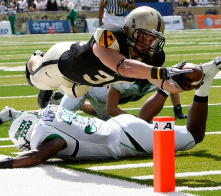 Army slot back Jonathan Crucitti dives over North Texas defender A.J. Penson as he tries to reach the end zone during the first half of Saturday's game at West Point. Crucitti was ruled out of bounds on the play. (Mike Groll / The Associated Press)