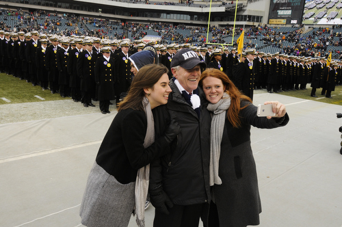 Navy Secretary Ray Mabus takes a picture with his daughters Annie and Elisabeth before the 114th Army-Navy football game. (Mike Morones/Staff)