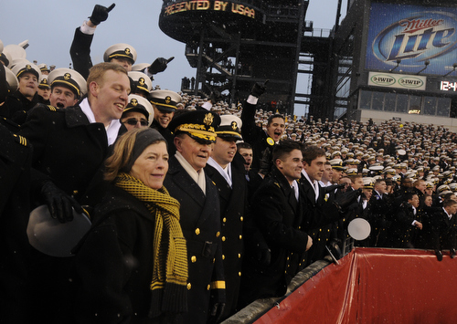 Chairman of the Joint Chiefs Gen. Martin Dempsey spends a few minutes in the first quarter with the midshipmen during the 114th Army-Navy football game at Lincoln Financial Field in Philadelphia, Pa., on Saturday, December 14, 2013. (Mike Morones/Staff)