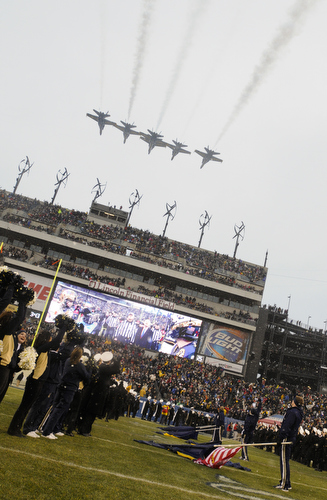 The Blue Angels fly over Lincoln Financial Field in Philadelphia, Pa., on Saturday, December 14, 2013 before the start of the 114th Army-Navy football game. (Mike Morones/Staff)