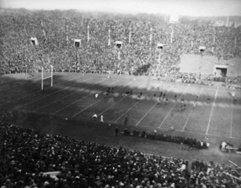 "The original Associated Press caption for this image, under the header ""Football College Game Action Yale Bowl Yale vs Westpoint"": ""At Yale's bowl, New Haven, Conn, with a score resulting in 7-7. Woods of the Army, making forward pass to Neale of Army fourth quarter, who makes a gain of forty yards on Oct. 28, 1922."" It was Army's second non-Navy road game ever; the first was a loss at Yale Bowl the previous year."