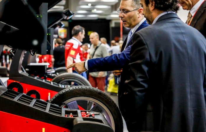 Autopromotec attendees view the latest wheel balancers.