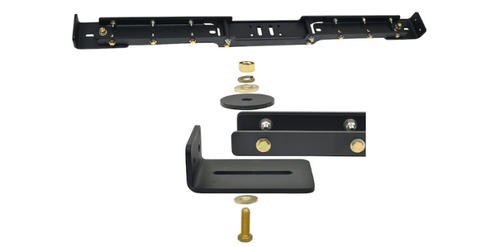This image shows the X Wide cross member. It is a black-colored bracket with various screws and bolts. There are nuts and washers and various other brackets, all photographed on a white background.
