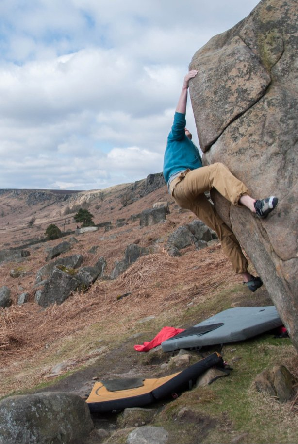 Tom working his way up a slopery arete using the heel hook at the Plantation