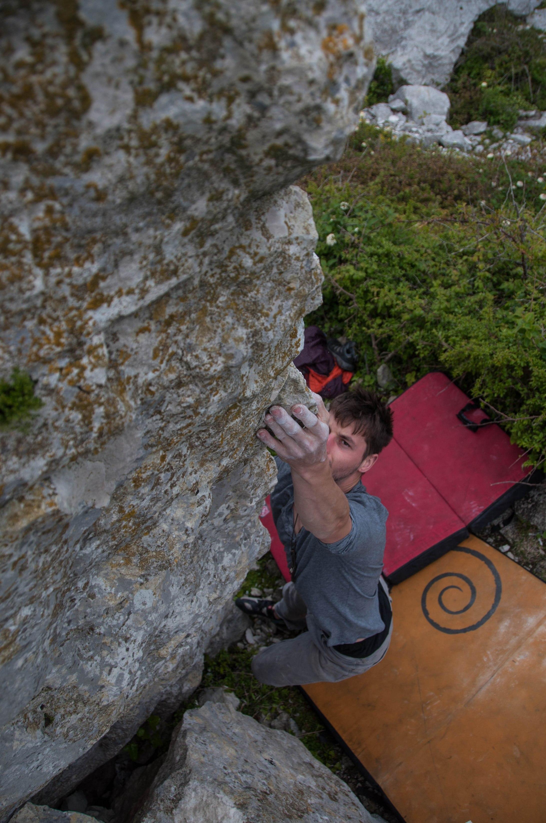 Pymn getting the reach at 'Bird Shit Boulder'.