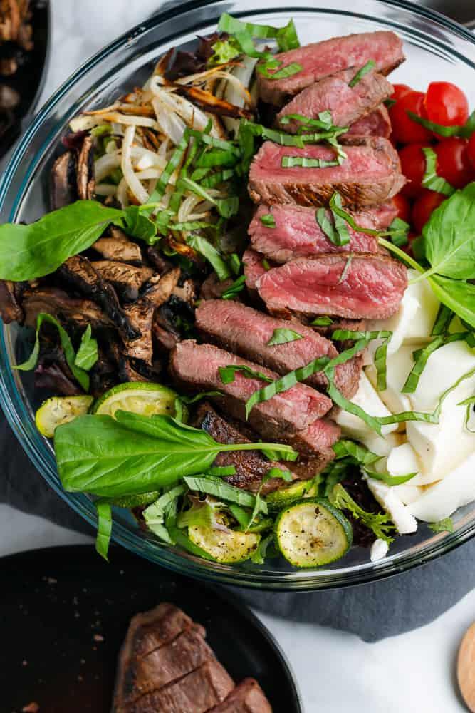 sirloin steak salad with fresh basil and roasted veggies