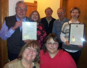 March was CGFM Month! At the March lunch meeting, we gathered together all the CGFMs in attendance for a photo with the proclamations signed by Governor Walker and Mayor Soglin. Pictured left to right: Back row: Allen Vick, CGFM-Retired, Joanne Schultz, CGFM, Edward Tuecke, CGFM, David Mellem, CGFM, Julia Lengyel, CGFM candidate* Front row: Mary Laufenberg, CGFM, Sherri Voigt, CGFM *has passed all 3 parts of the exam and is completing the work experience requirement