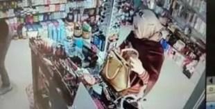 سيدة انيقة تسرق محل أدوات تجميل