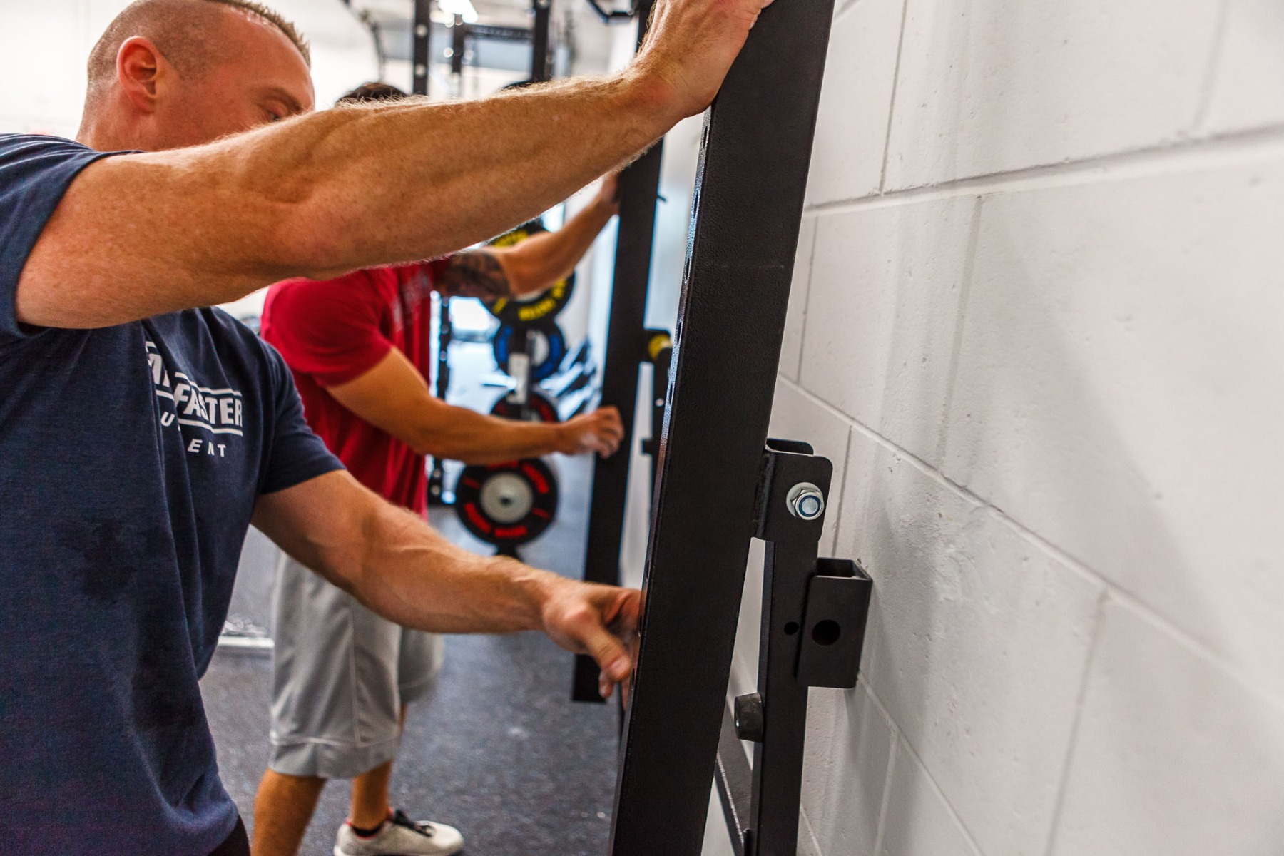 again faster team wall mounted folding squat rack