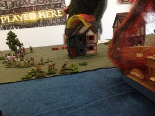 Playtest photo. The English land in the lower town, setting afire a waterfront building and a ship