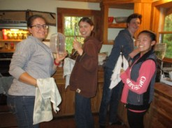 Sam, Aria, Troy and Grace washing dishes