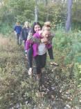 Carley giving Xochitl a piggyback ride across long wet stretch of Quabbin walk
