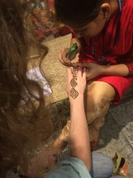 Killing time in New Delhi with free henna.