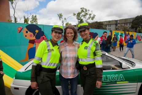Cassie and Colombian police offers, in front of their Ferrari police car!