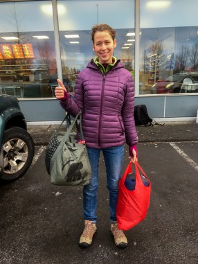 """Here's the size of our free carry on luggage with Wow Air. In the green bag is the tiniest """"included"""" cary on luggage and the red back (pretty much just my seeping bag) is my personal item."""