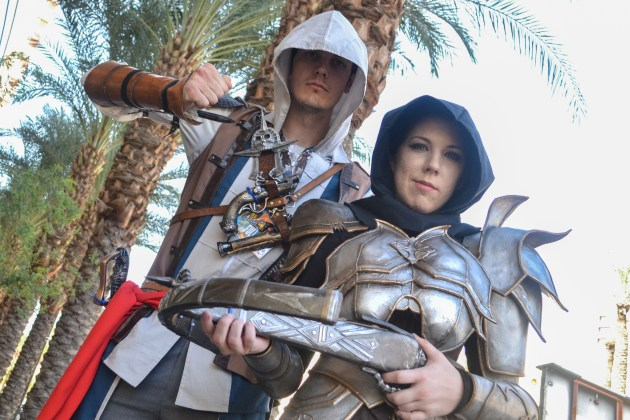 Floyd Kellog (left) and Mary Buchanan (right) hold up their weapons at Comicon in downtown Phoenix Saturday afternoon.